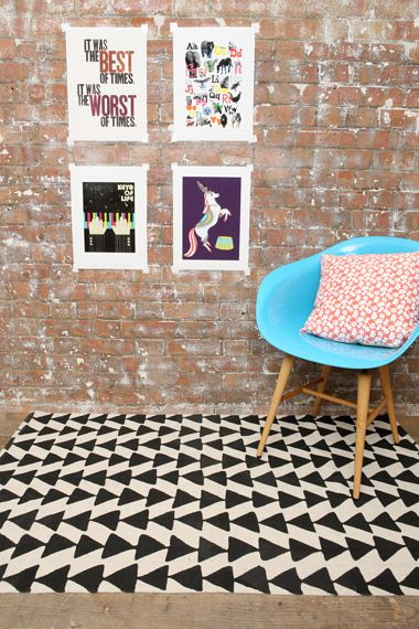 Home/interior - black arrow rug & bright blue modern chair with orange graphic pillow