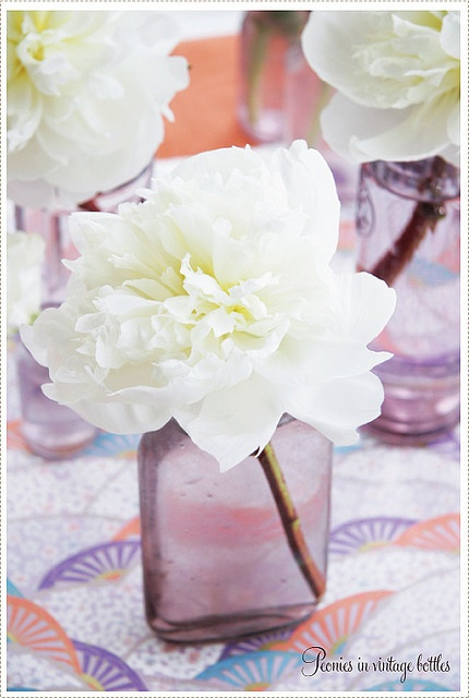 Peonies and bottles.