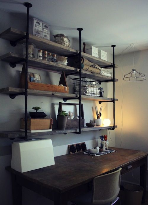 industrial wood shelves mounted from the ceiling.