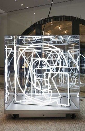 Grey Group / neon deconstructed lace sealed in a glass cube
