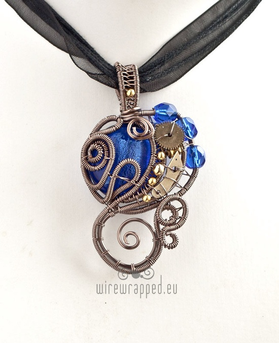 This is pretty - Blue steampunk wire wrapped pendant.
