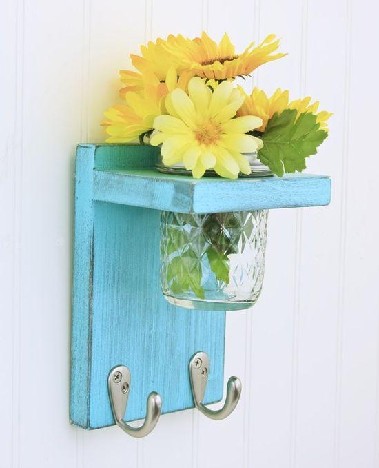 mason jar flower holder and key hooks in one.