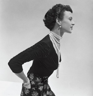 I adore the ruched sleeves/neckline and the luxurious strands of classic pearls. #vintage #1950s #fashion
