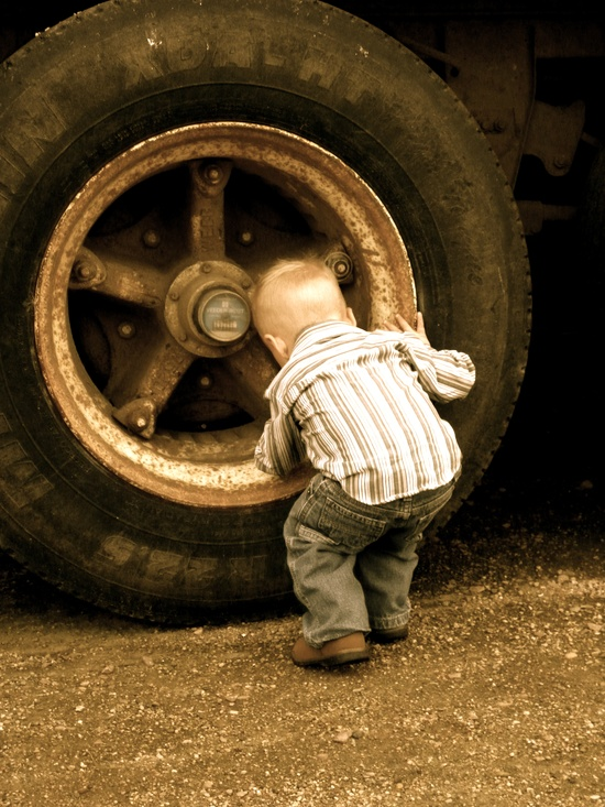 little boy and giant tire