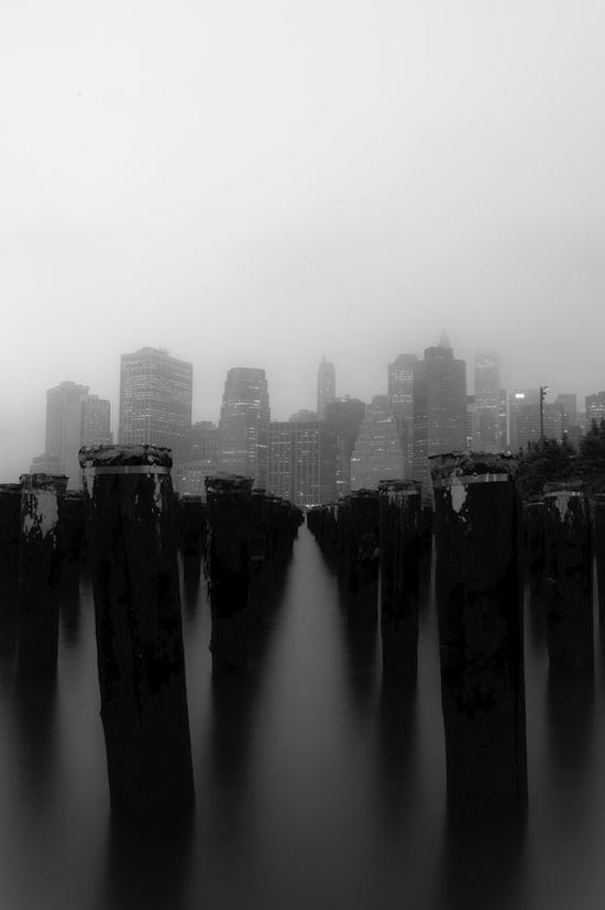 Manhattan over brooklyn's pilings.