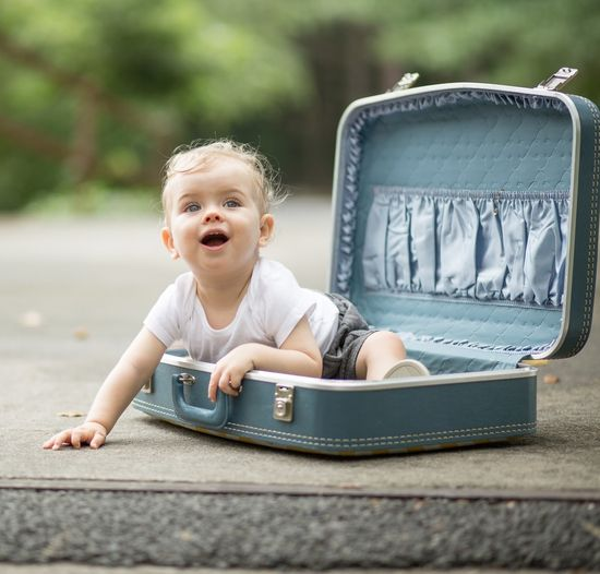 baby boy in a suitcase...