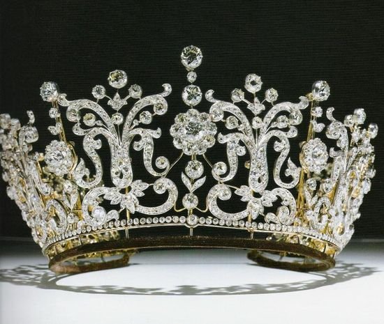 Made for Florence, the wife of the second Baron Poltimore, treasurer to Queen Victoria's household 1872-1874. Later owned by HRH Princess Margaret. Like many of the tiaras in the royal family, the poltimore tiara was seen in several alternative forms such as a diamond fringe necklace and as brooches; the tiara can be converted into a necklace and eleven brooches, and was offered with a screwdriver and the brooch fittings required to make the switch