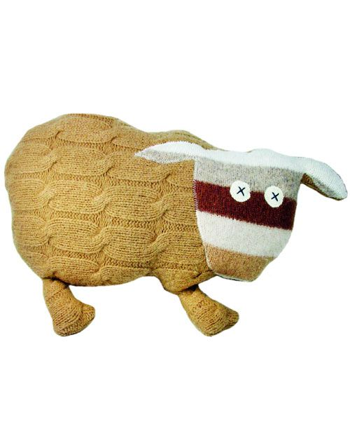 Pillow Pal.  Martha Stewart crafts.  This is actually sewn together from felted wool sweaters or scraps.  Template & video, also a sheep & elephant to make.  So cute.