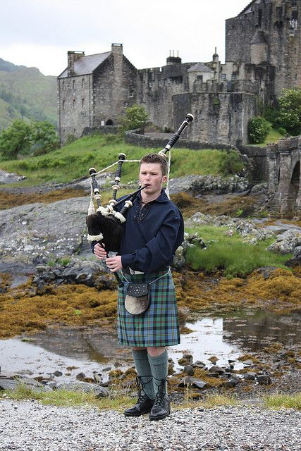 Young Piper at Eilean Donan Castle, Scotland, by Tony Jones