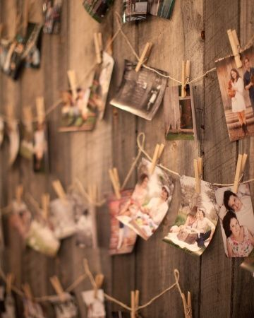 This couple hung photos from clothespins for personalized reception decor