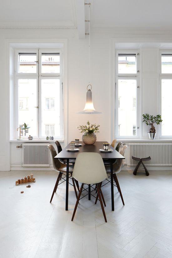 Scandinavian design. Eames style Chairs. Monochromatic color scheme. Herringbone floors.