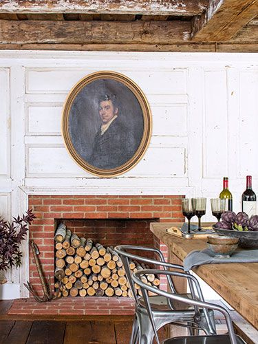 A mid-1800s portrait feels apropos against the dining area's original wood paneling.
