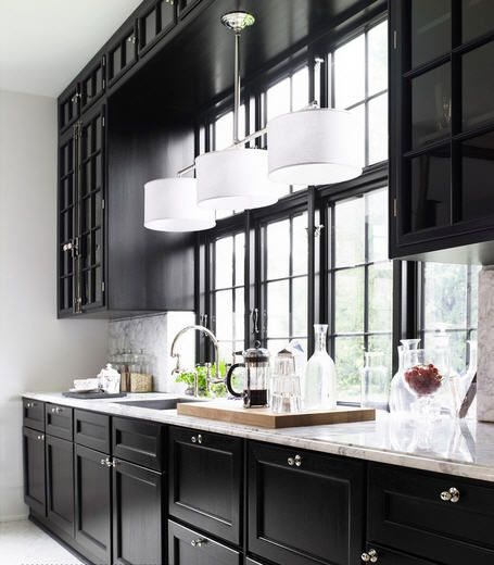 black cabinets & lots of windows! I would never leave the kitchen!