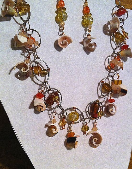 orange and yellow shell spirals beaded necklace by BeadingByJenn, $30.00 #jewelry #necklace #shells #beach #wedding #spiral #swirls