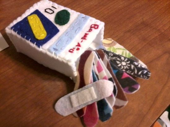 felt bandaids made with velcro pads so they will stick to stuffed animals.