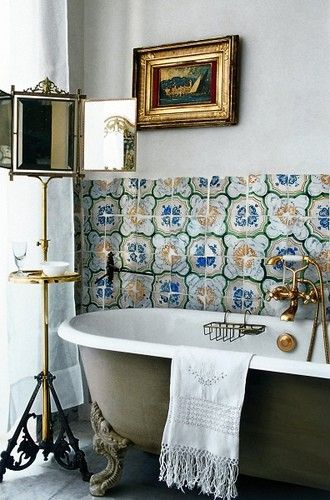 Tiles + green-coated porcelain tub + shelf mirror = the guest house downstairs bath