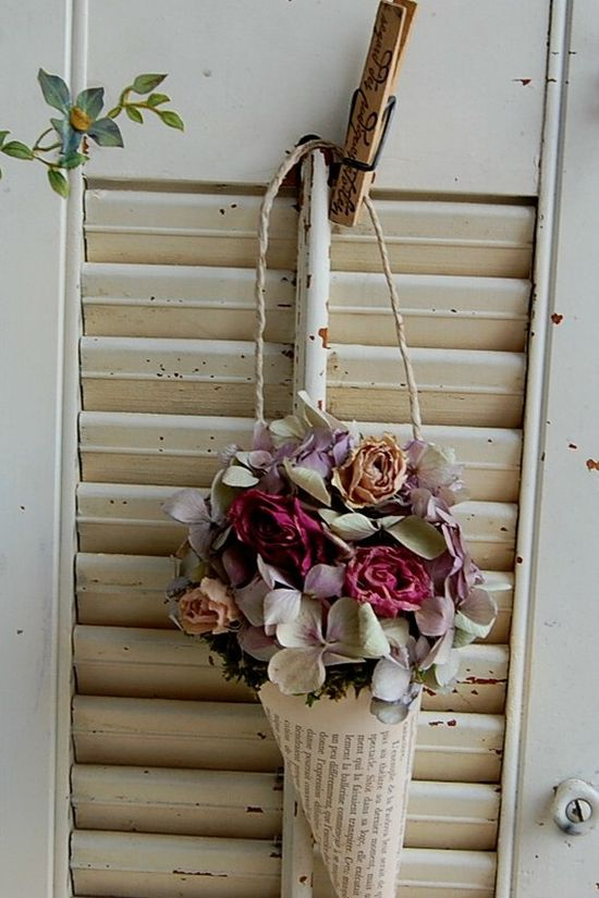 pretty dried flower arrangement in a book page cone