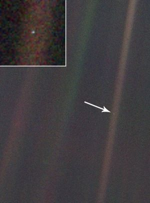 Pale Blue Dot: Earth as seen from Voyager 1 while on the edge of our solar system (approximately 3,762,136,324 miles from home) more than twenty years ago. (click image to read Sagan's wise words)