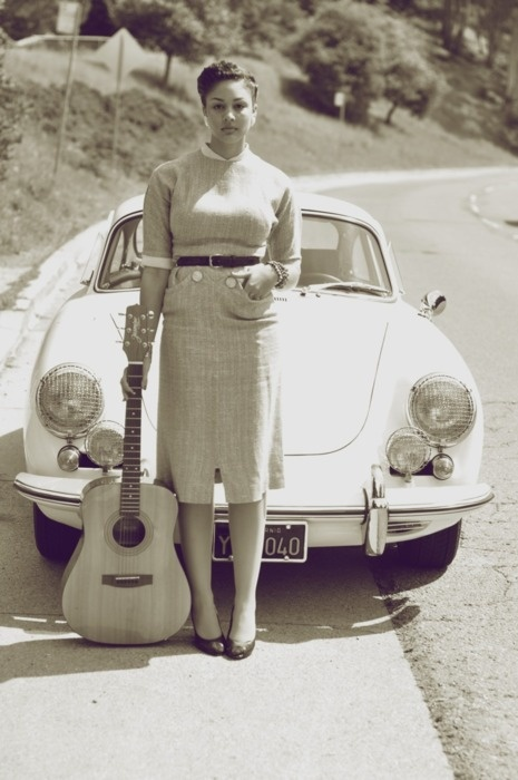 Musical girl in front of Porsche - 1950's