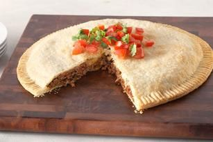 Gotta Empanada - Gotta eat? Check out our empanada. Filled with all the same cheesy-salsa goodness as the handheld version, this one comes together quickly and cuts like a pie.