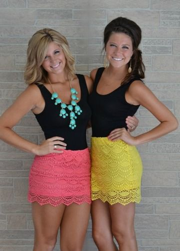 Black top with a colorful lace skirt. Love this look!