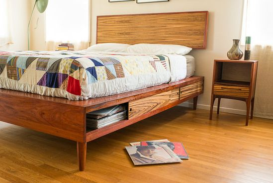 Clever storage is built right in to this handmade bed.