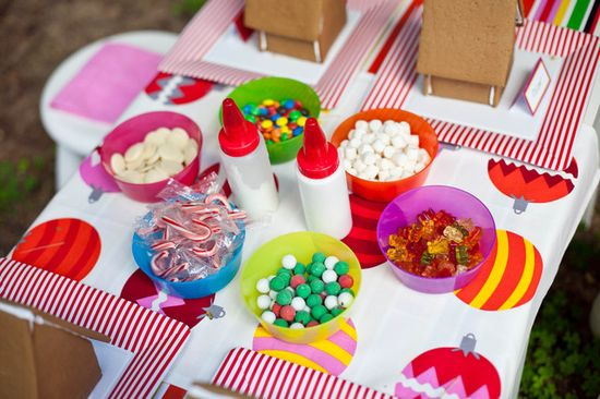 Love these decorations for gingerbread houses at an IKEA Christmas party!  See more party ideas at CatchMyParty.com!  #partyideas #christmas
