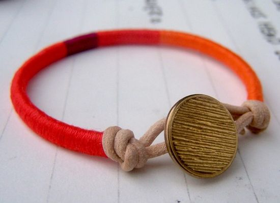 Hand wrapped bracelet made of cotton thread and leather.