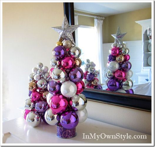 Non permanent Christmas Tree made out of ornaments.