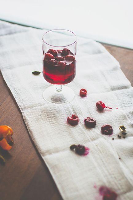 Elder Martine: muddled cranberries, gin, clove-infused vodka, tri-berry gastrique, lemon juice, Lillet Blanc, rose-hibiscus bitters