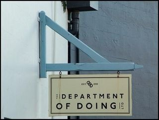Department Of Doing sign above office