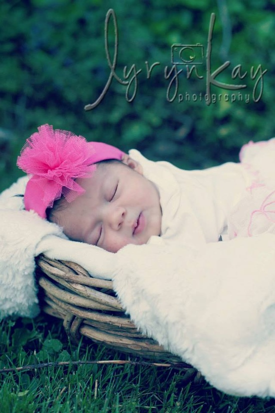 Newborn photography outdoors - baby in basket - Lyryn Kay Photography