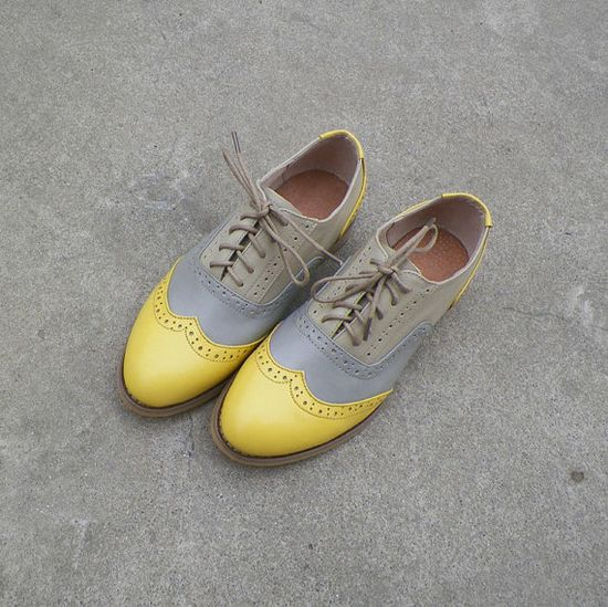 Grey and yellow leather Oxford shoes.