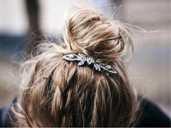 Add some sparkle by topping off a windswept hairdo with a prim little brooch.