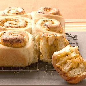 A slightly sweeted dough is rolled around a chedder and onion filling, then baked until golden brown for these rolls.