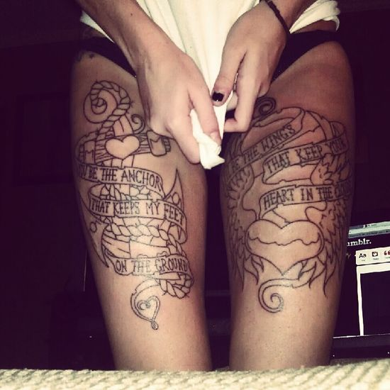"""You be the anchor that keeps my feet on the ground. I'll be the wings that keep your heart in the clouds."" Thigh tattoo."