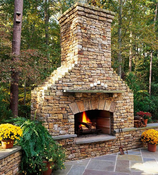Love this outdoor fireplace