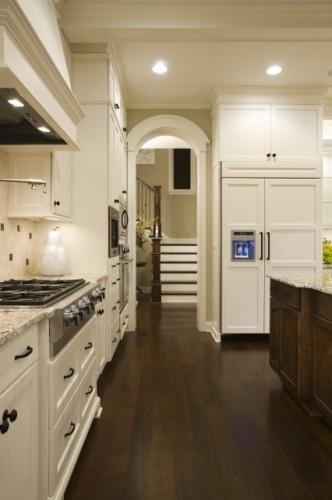 white cabinets, rustic black hardware, dark floor, dark island