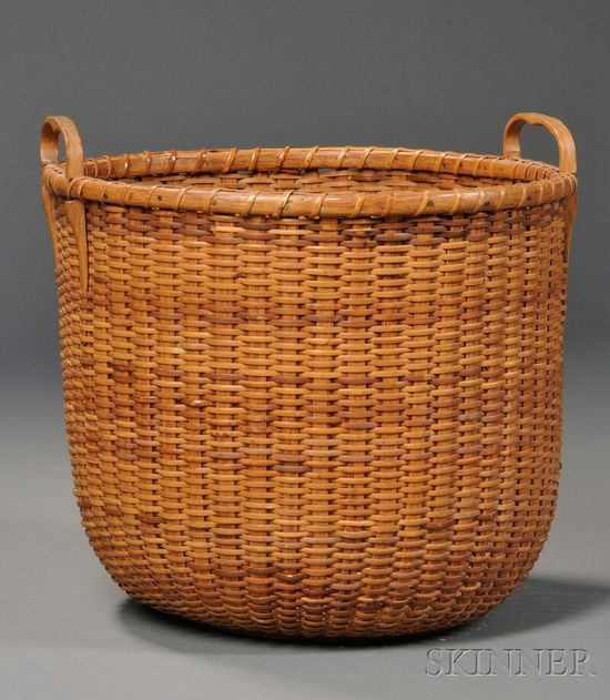 "Round Nantucket Basket, made by A.D. Williams, Nantucket, ac. 1910-40, deep round form with carved hardwood handles and turned base, the base inscribed ""Light Ship Basket/Made by A.D. Williams/Nantucket, Mass.,"" (minor loss), ht. 11 3/4, dia. 12 1/2 in."