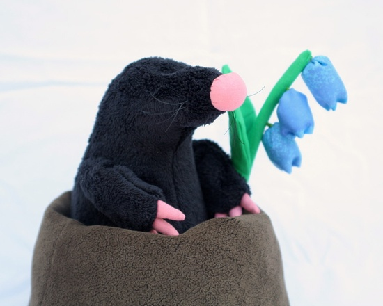 Black Mole Plushie in molehill with flower, stuffed toy for children.