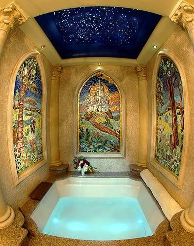"The bathroom of the Cinderella Castle Suite includes a ""garden tub"" whirlpool sauna. The walls are inlaid with mosaic tiles and a canopy of twinkling lights sparkles above."