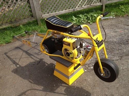 Briggs and Stratton Raptor Drag Race Mini Bike.. Wheelie Bar and Banana Yellow Frame. Trick Stuff Here!