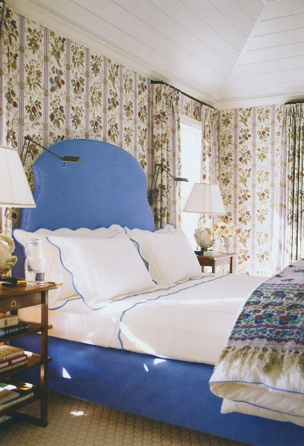 katie ridder traditional bedroom--floral wallpaper, embroidered linens, periwinkle upholstered headboard