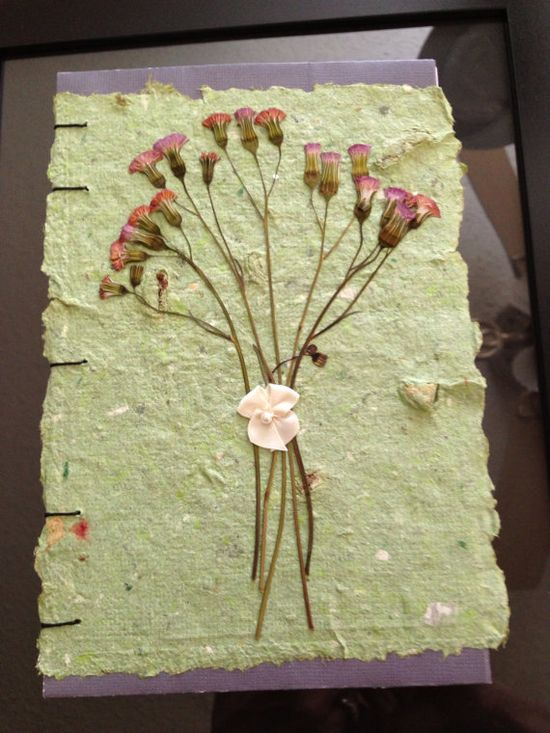 Handmade paper makes a beautiful journal cover. Not crafty?  Check out etsy for hundreds/thousands of up cycled products.