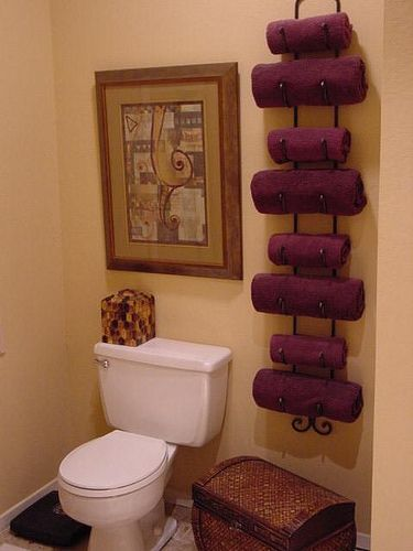 Wine rack as a towel rack. What a great idea for a small bathroom.