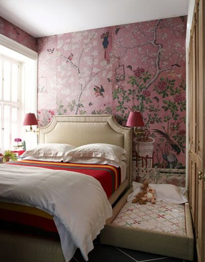 in love with the gorgeous vintage wallpaper used in this space.