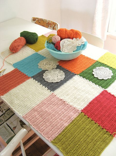 Crochet blanket with doilies.