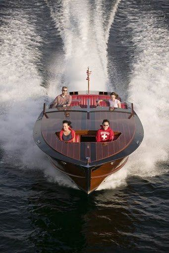 Most people want a sports car for their midlife crisis, I want a vintage wooden speedboat like this.