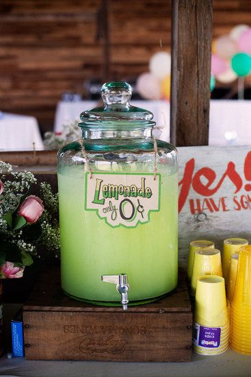 Handmade signs playfully identify the beverages while tying in the carnival theme!