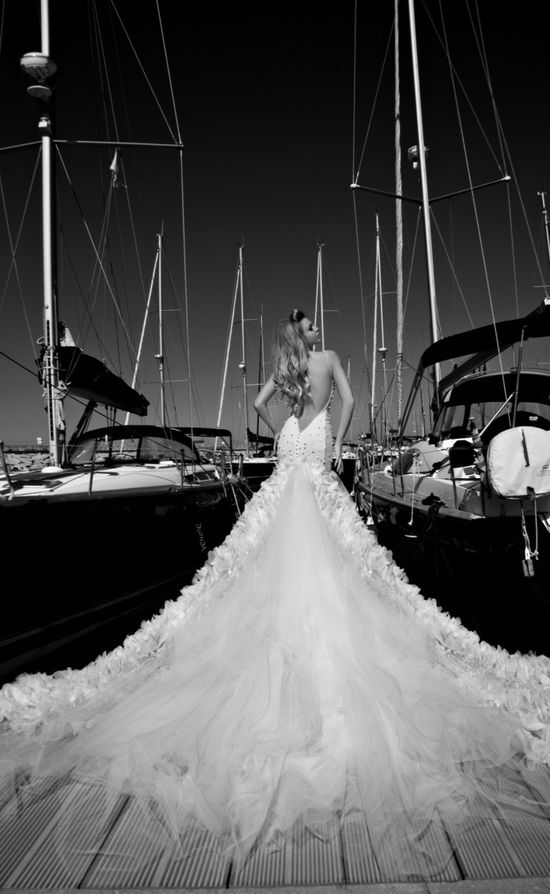 The Galia Lahav Pearl -  a sheer net dress, entirely embroidered with pearls and crystals. And look at that train, wowza! www.galialahav.co...